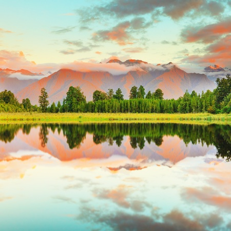 south island new zealand: Reflection of the mountains in Matheson lake