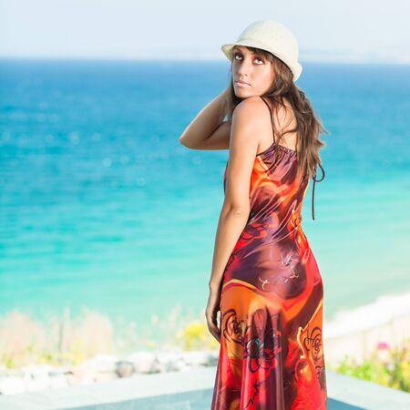 Woman in hat near the sea Stock Photo - 13442132