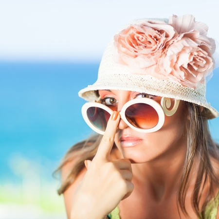Beautiful woman in sunglasses and hat outdoor Stock Photo - 13441039