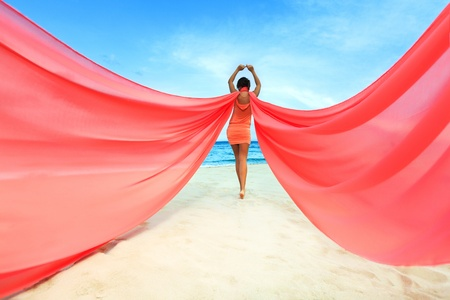 Woan with red scarf on the beach Stock Photo - 13442193