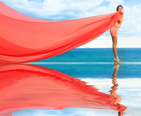 Woan with red scarf on water Stock Photo - 13545795