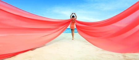 Woan with red scarf on the beach Stock Photo - 13545683