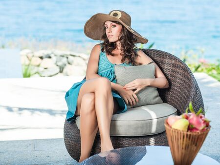 Woman in hat near the pool Stock Photo - 13588835