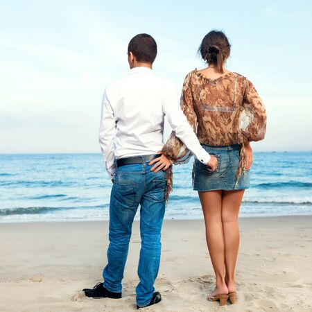 Young couple. Sea on the background photo