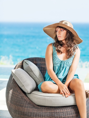 Woman in hat near the pool Stock Photo - 13717807