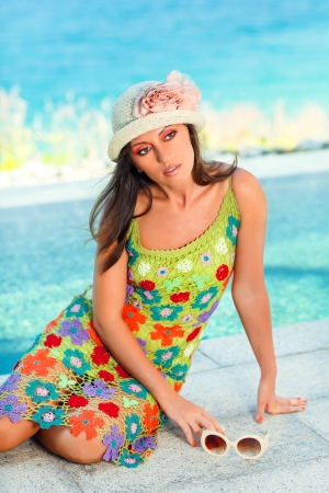 Beautiful woman in sunglasses and hat outdoor photo