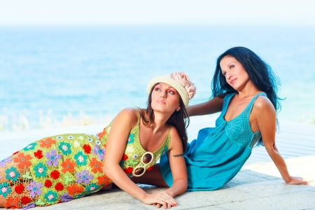 Two beautiful woman near the pool photo