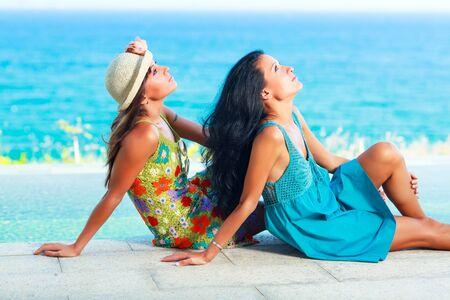 Two beautiful woman near the pool Stock Photo - 13757350