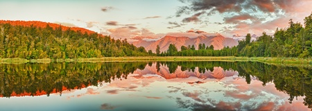 Reflection of the mountains in Matheson lake. Panorama photo