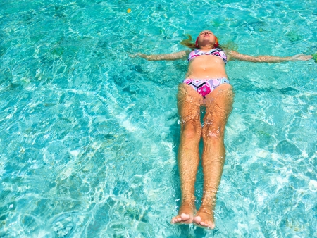 Beautiful woman relaxing on the water surface photo