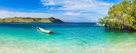 komodo island: Seaspace panorama  Boat on the foreground Stock Photo