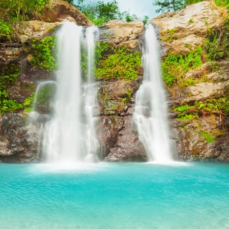Beautiful waterfall in tropical rainforest photo