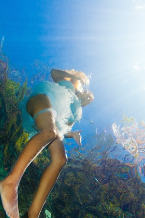 Fashion beautiful woman underwater like a mermaid photo