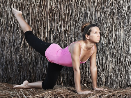 Beautiful young woman doing yoga exercises photo