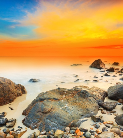 Sunrise over the sea. Stone on the foreground Stock Photo - 14642952