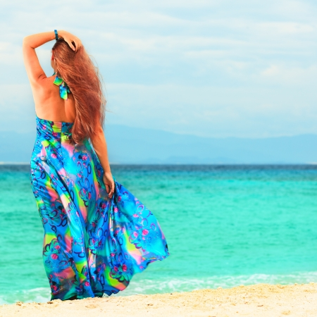 Rear view of woman near the sea Stock Photo