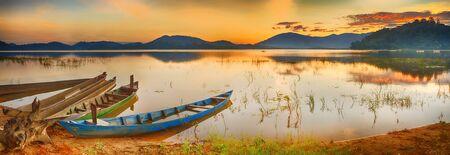 fisherman boat: Panorama of a Lak lake at sunrise Stock Photo
