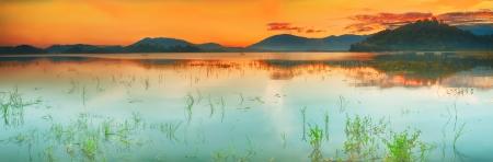 tonight: Panorama of a Lak lake at sunrise Stock Photo