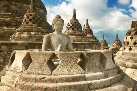 stone buddha: Buddha statue in stupa  Borobudur  Java  Indonesia