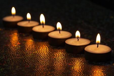 6 years: Burning candles on dark background
