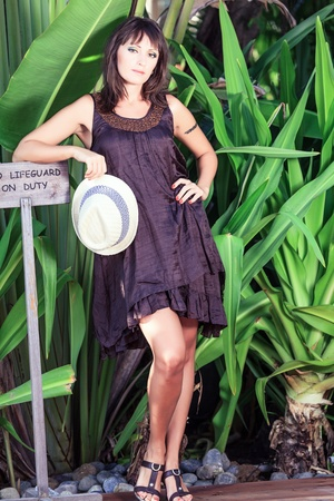 Beautiful Young woman poses in the tropical garden Stock Photo - 18434408
