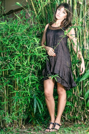 Beautiful Young woman poses in the tropical garden Stock Photo - 18434417