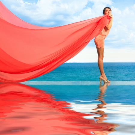 Woman with red scarf on water photo