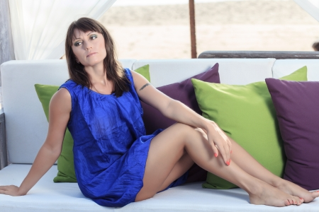 young beautiful woman chilling on a lounge Stock Photo - 18683213