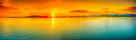 panoramic beach: Sunrise over the sea. Panorama