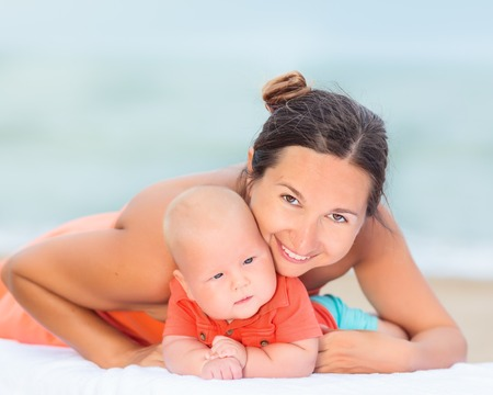 sunbed: Baby and mom are relaxing on sunbed