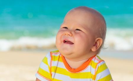Cute baby on the tropical beach photo
