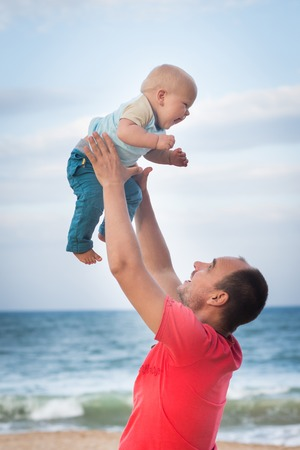 Baby and father having fun time  photo