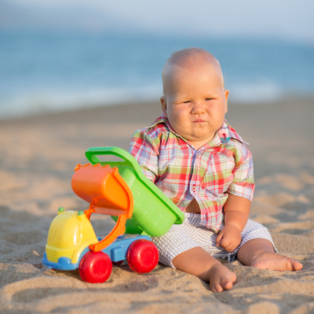 Cute baby is playing toy car photo