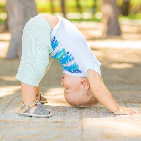 Baby doing yoga exercises