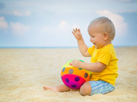 Baby playing with toy ball photo