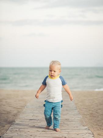 flatfoot: Baby walking along the beach