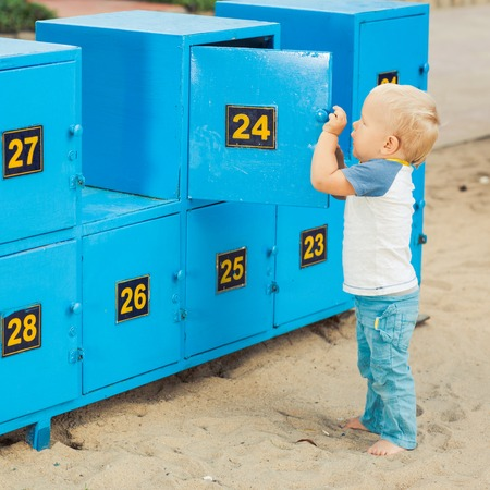 son deposit: Baby stays near safety boxes