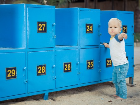 stays: Baby stays near safety boxes