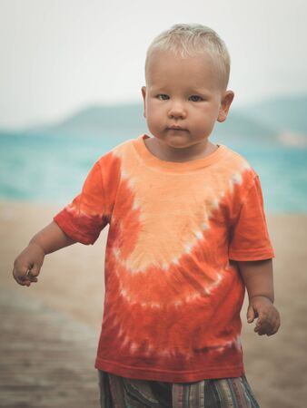 flatfoot: Baby walking along the beach
