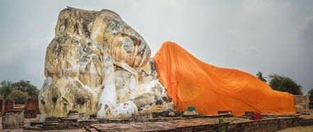 si: Giant Reclining Buddha in Wat Lokayasutharam. Ayutthaya historical park. Panorama