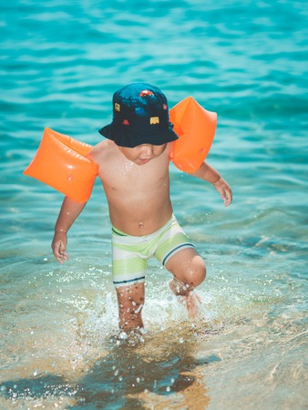 armbands: Baby with armbands in a sea Stock Photo