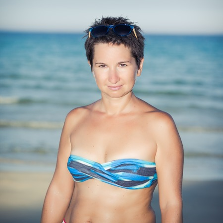 Happy woman near a sea