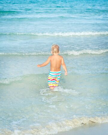 short wave: Baby looking sea on the beach
