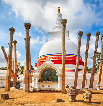 dagoba: Thuparamaya dagoba in the sacred world heritage city of Anuradhapura, Sri Lanka. Stock Photo