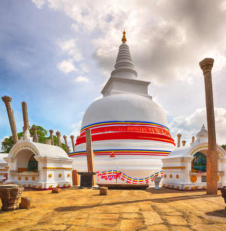 dagoba: Thuparamaya dagoba in the sacred  city of Anuradhapura, Sri Lanka. Stock Photo