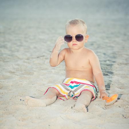 oversized: Funny toddler wearing oversized sunglasses