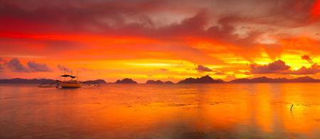 philippine: Traditional philippine boats bangka at sunset time. Panorama Stock Photo