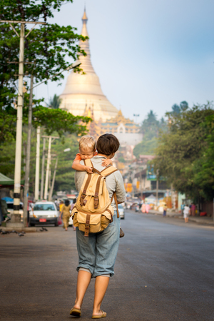 going places: Tourists are going to Shwedagon pagoda in Yangon. Myanmar Stock Photo