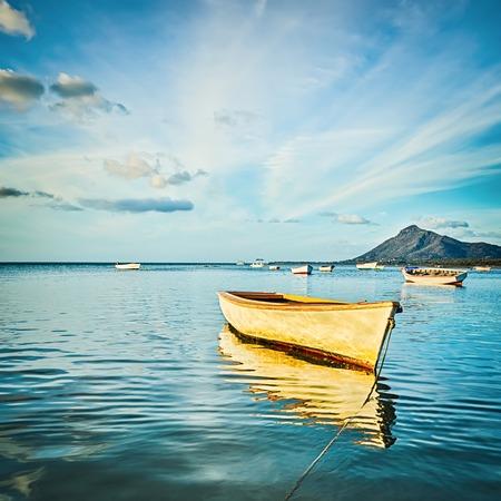Fishing boat at sunset time. Mauritius