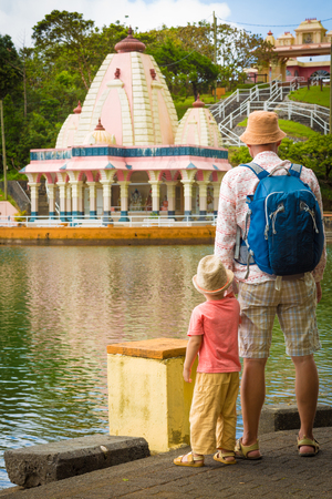 grand father: Father and child at Ganga Talao temple. Mauritius.